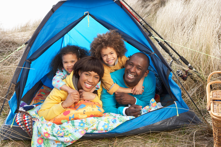 A family goes camping for Father's Day.