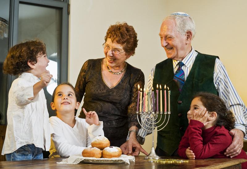 A family celebrates Hannukah.