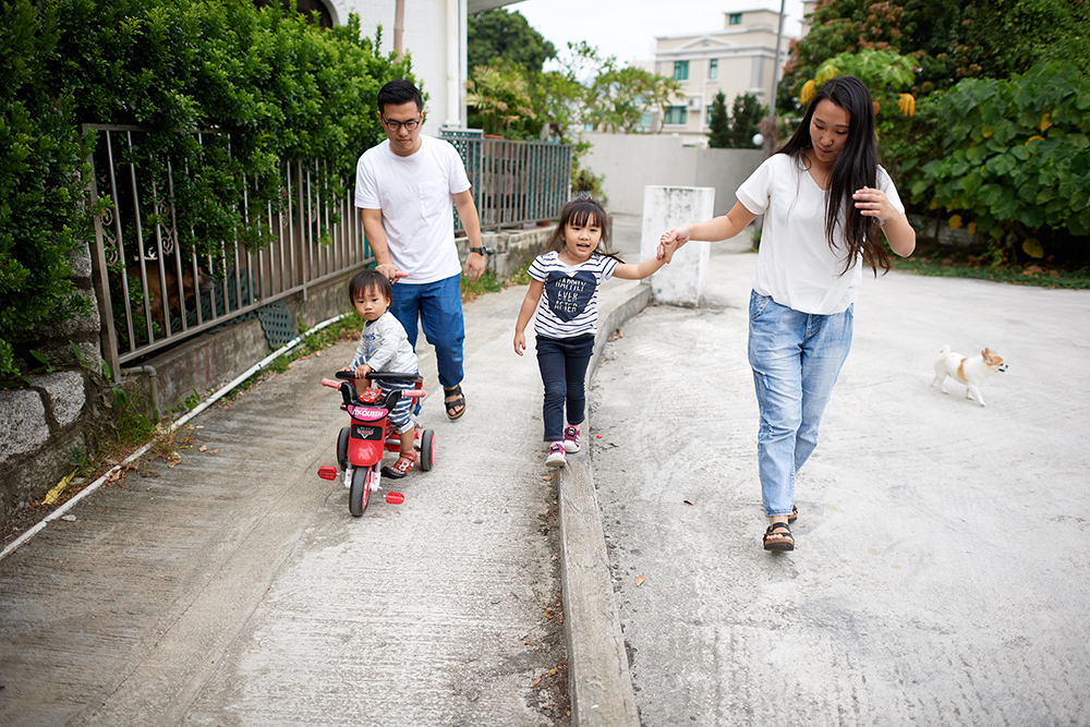 a chinese family walks through their city.