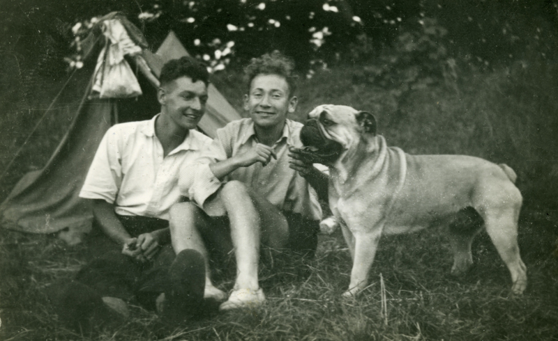 Old family photo of two brothers and their dog.