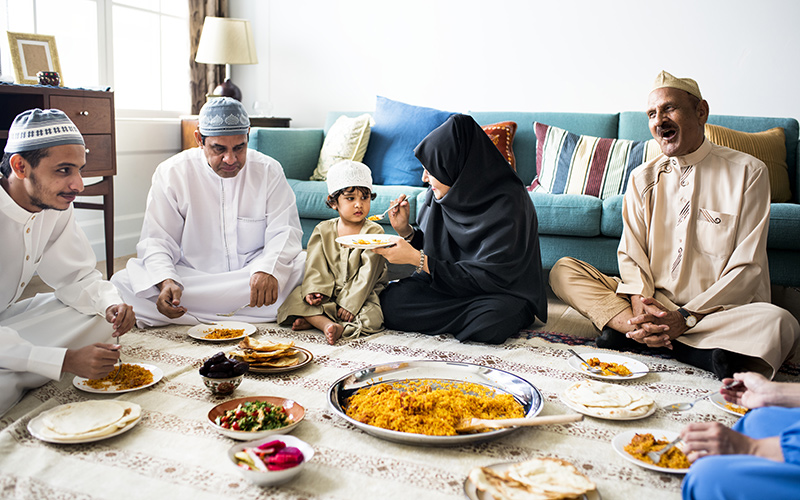 a family shares middle eastern food.