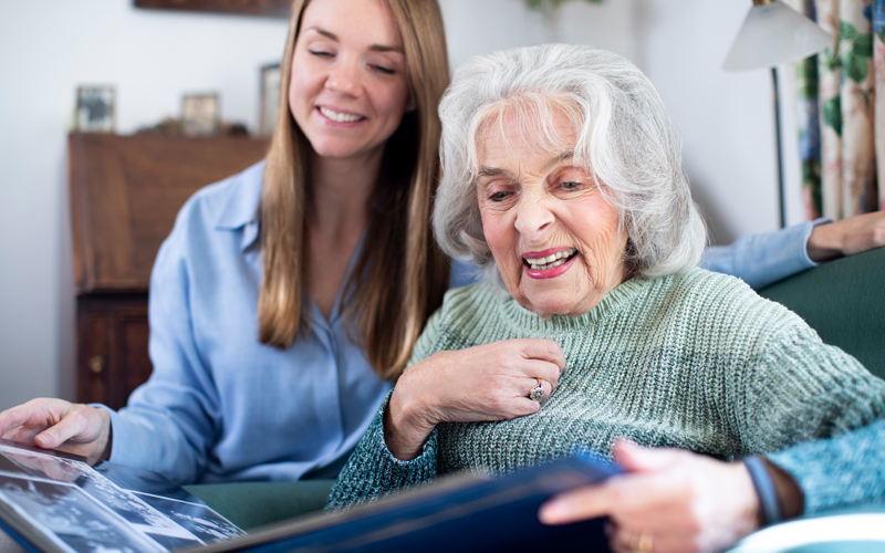 A girl does genealogy work with her grandmother.