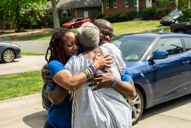 A family on Relative Race, a popular genealogy tv show, hugging eachother