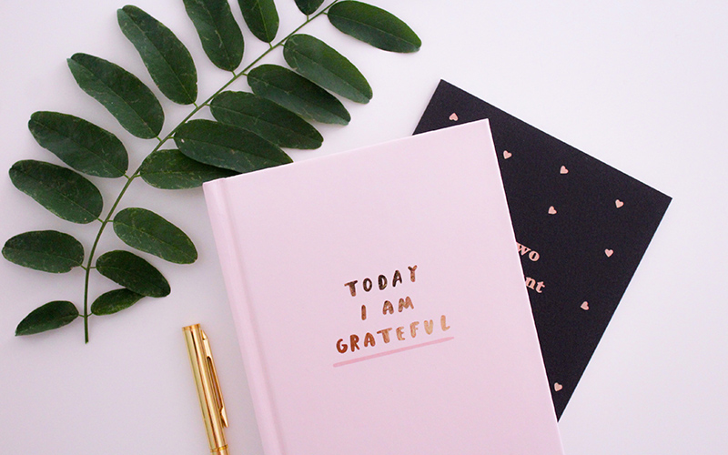 """Gratitude journal that says """"Today I am grateful"""" on front cover."""