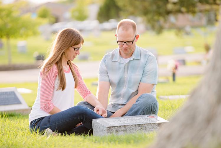 A couple visits a gravesite