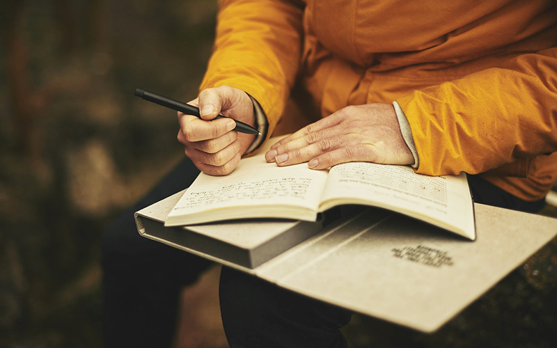 Jotting down a few thoughts in a journal.