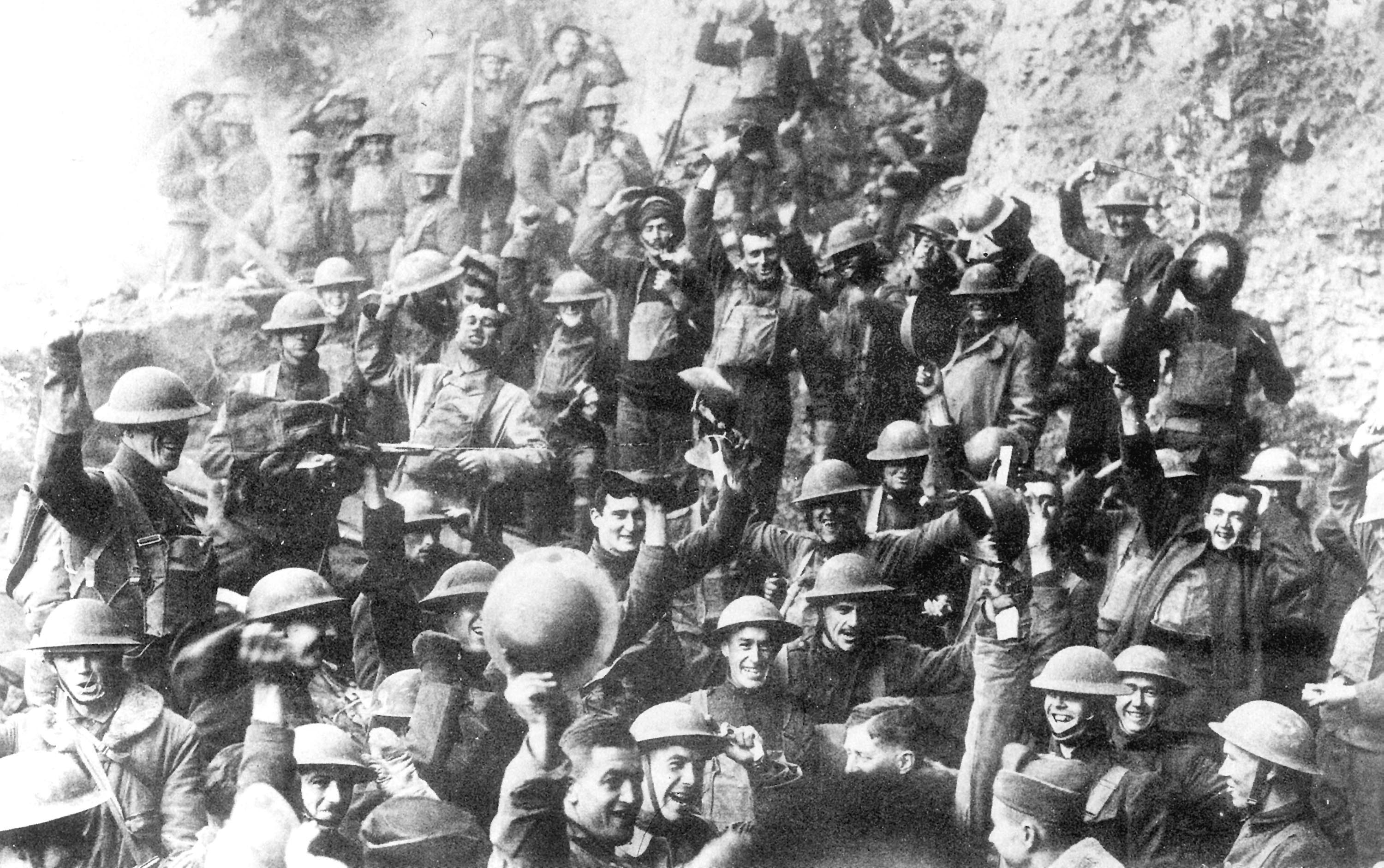 an infantry of World War 1 soldiers celebrate the armistice.