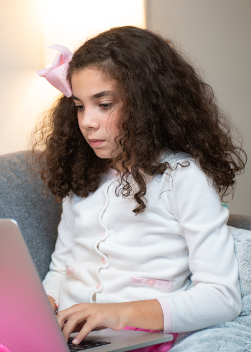 a young girl on a computer
